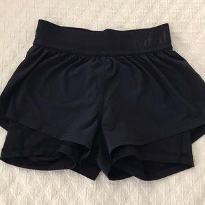 Lululemon bike shorts with shorts over.
